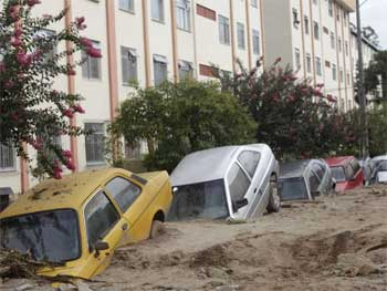 Cars buried in mud
