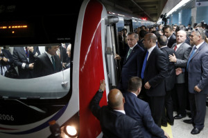 Turkish Prime Minister Erdogan arrives to test-drive a train as he attends the opening ceremony of the Marmaray railway.