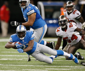 Reggie Bush #21 of the Detroit Lions dives for extra yards against the Tampa Bay Buccaneers on November 24 at Ford Field in Detroit.