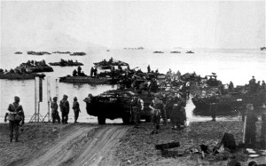 Amphibious landing craft loaded with British infantry coming ashore near Anzio, Italy, in 1944