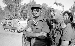 Ariel Sharon (R), recovering from a head injury, with Moshe Dayan on the western side of the Suez Canal in October 1973
