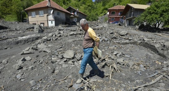 Torrential rain has triggered hundreds of landslides, like here in the Bosnian village of Topcic Polje.