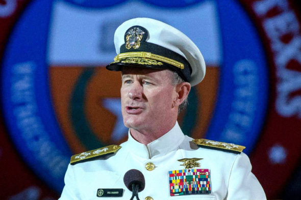 "Naval Adm. William H. McRaven does the ""hook 'em horns"" sign at the end of his keynote address at The University of Texas at Austin Saturday night (May 17). McCraven is the ninth commander of the United States Special Operations Command and is  best known"