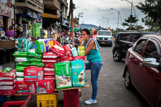 "A vendor sells diapers from Venezuela on the street in Cúcuta, Colombia. ""Everything you see on this street is Venezuelan,"" says Alejandro Valbuena, a 32-year-old merchant."