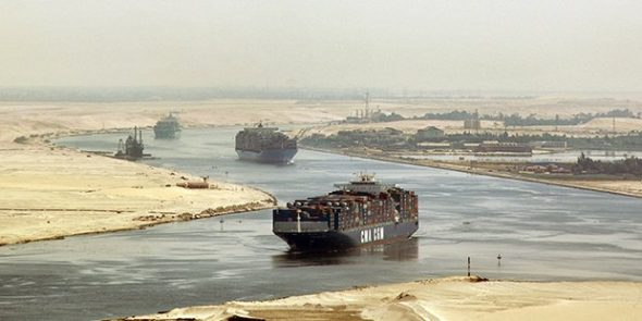 A ship crossing the Suez Canal (from the Cairo Post)