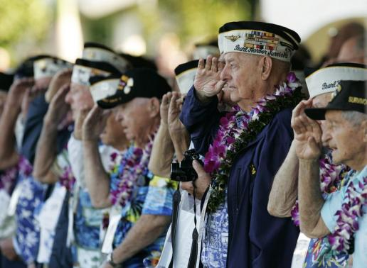 Louis Conter a USS Arizona survivor and other Pearl Harbor survivors salute as the USS Chung-Hoon passes by during ceremonies honoring the 73rd anniversary of the attack on Pearl Harbor at the World War II Valor in the Pacific Nat