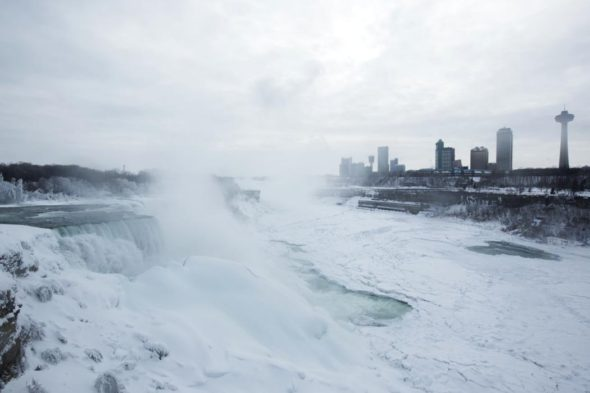 A snow-covered landscape is seen over the frozen Niagara Falls in Niagara Falls, New York February 17, 2015.  Temperatures dropped to 6 degrees Fahrenheit (-14 Celsius) on Tuesday and the National Weather Service issued a Wind Chill Warning in Western New York from midnight Wednesday to Friday.  Picture taken February 17, 2015.  REUTERS/Lindsay DeDario