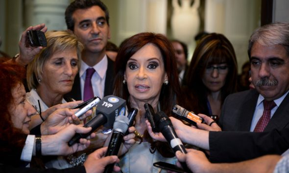 Argentine President Cristina Fernández de Kirchner talking to journalists at the presidential palace in Buenos Aires in December 2014.