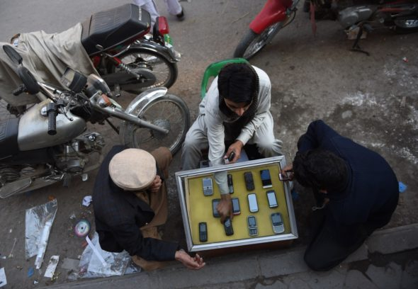 A Pakistani mobile vendor deals with customers at his roadside stall in Rawalpindi on Jan. 6.