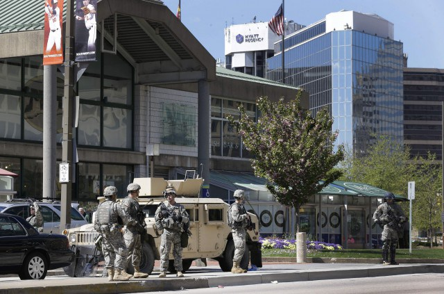 Maryland National Guardsmen patrol near downtown businesses in Baltimore, Tuesday, April 28, 2015, a day after looting and arson erupted.  (AP Photo/Patrick Semansky)