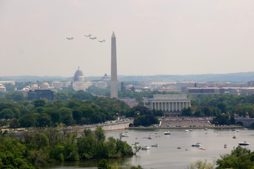 Four North American P-51 Mustangs fly over the National Mall on Friday in commemoration of the 70th anniversary of V-E Day and the end of World War II. (Brian M.K. Allen)