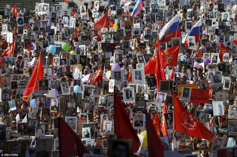 Around 500,000 people marched through central Moscow with portraits of their relatives who fought in WWII. President Putin surprised Russians by unexpectedly joining the mammoth procession on Red Square, a portrait of his veteran father Vladimir in his hand.