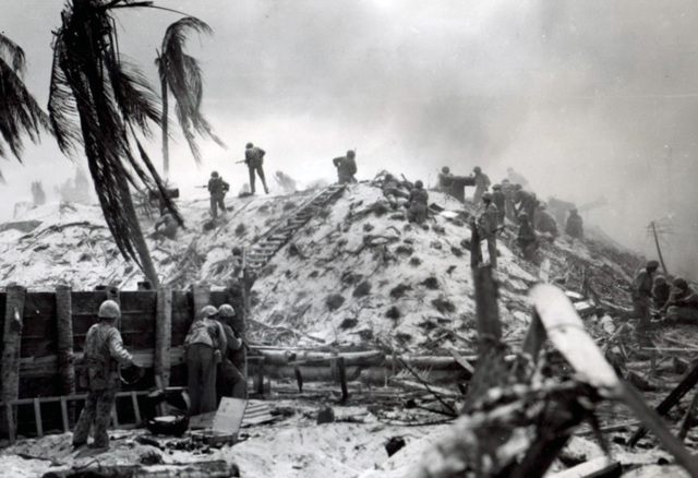 "Knoxville native Marine 1st Lt. Alexander ""Sandy"" Bonnyman, Jr., stands atop the bunker where he was killed during the battle of Tarawa on Nov. 22, 1943. Bonnyman, center at the top of the makeshift ladder, was awarded a Congressional Medal of Honor for his bravery."