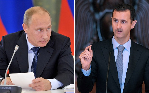 Bashar al-Assad (right) has sent his personal thanks to Vladimir Putin for his support over Syria. (Photo: AP/REX FEATURES)