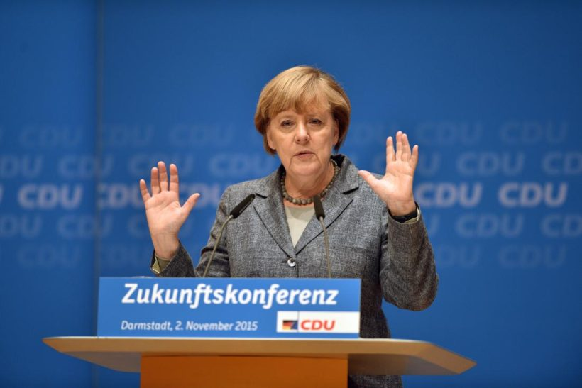"DARMSTADT, GERMANY - NOVEMBER 02: German Chancellor and Chairwoman of the German Christian Democrats (CDU) Angelika Merkel speaks to CDU members while attending a regional ""Future Conference"" on November 2, 2015 in Darmstadt, Germany. Merkel is facing increasing criticism from members of her own party over her open migrants policy. Germany is expected to register over one million asylum applicants this year and local communities across the country are struggling to accommodate all the newcomers. Merkel has said the influx is unstoppable but has pushed for legislation to allow a faster deportation of rejected asylum applicants. (Photo by Thomas Lohnes/Getty Images)"