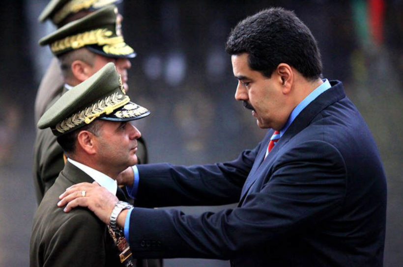"Venezuela's Socialist President Nicolas Maduro (right) has warned that if the opposition wins, his side is ""politically and militarily prepared to deal with it"" and would ""take to the streets."" (Photo: Merco Press)"