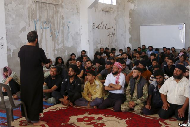 Rebel fighters from the Ahrar al-Sham Movement take Islamic and Koran lessons inside a camp, during the holy month of Ramadan in Idlib countryside, Syria, July 7, 2015. The group pulled out of a meeting of opposition groups in Saudi Arabia, Dec. 10.