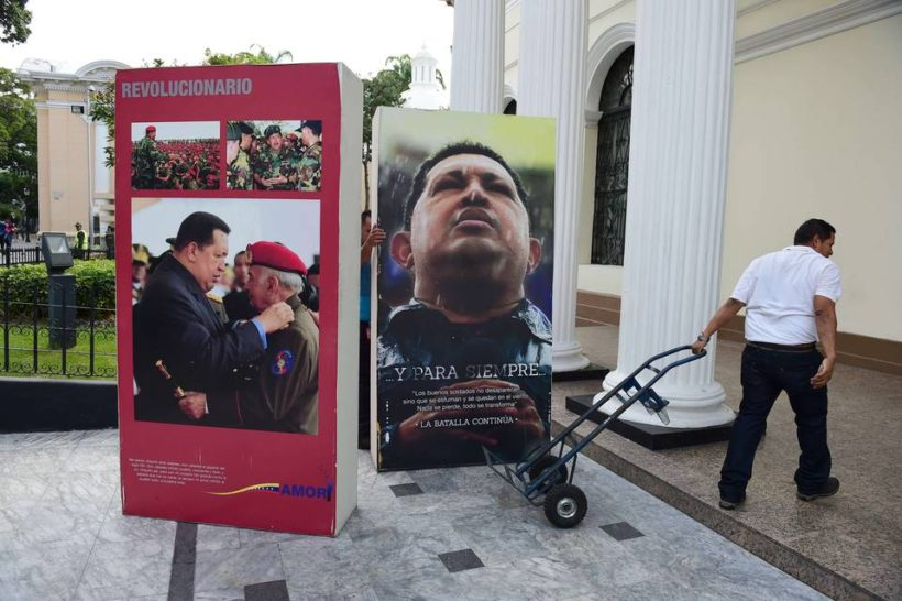 National Assembly employees removed pictures of the late President Hugo Chavez from the legislative building in Caracas on Wednesday. Venezuela's opposition has broken the government's long grip on the legislature.