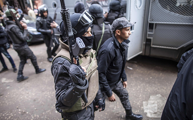 Members of the Egyptian police special forces patrol streets in al-Haram neighbourhood in the southern Cairo Giza district (Photo: AFP)