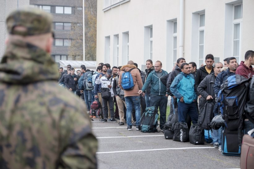 Asylum seekers arrive at a refugee reception centre in the northern town of Tornio, Finland