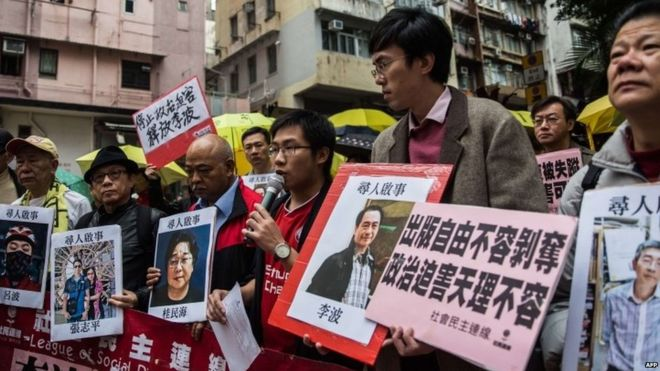 Protesters march on China's Liaison Office in Hong Kong to draw attention to the detentions