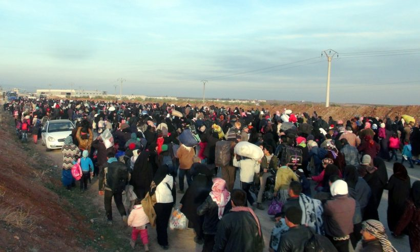 Syrians make their way to the Esselame border gate, in the Turkish province of Kilis, as they flee airstrikes in and around Aleppo. (Photo: The Guardian/Anadolu Agency/Getty Images)