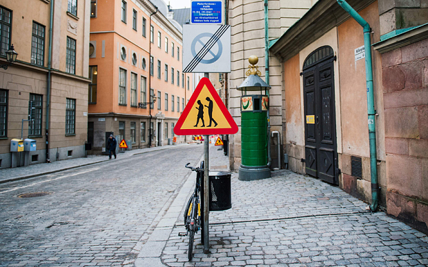 A road sign arning against pedestrians focusing on their smartphones is pictured on February 2, 2016 near the old town in Stockholm. ( AFP / Jonathan Nackstrand)