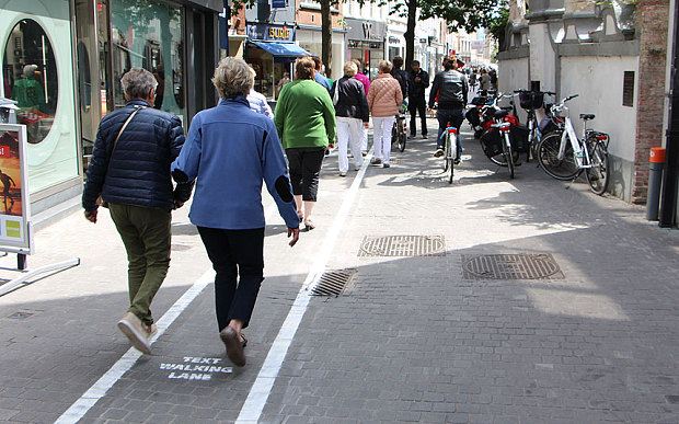 The white painted lines on the streets of Antwerp designate pathways for those more intent on their screens than paying too much attention to where they are walking. (Photo: Mlab/Shutterstock/Rex)