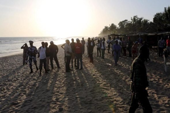 Emergency workers and security officers gathered on the beach after an attack in Grand Bassam, Ivory Coast.