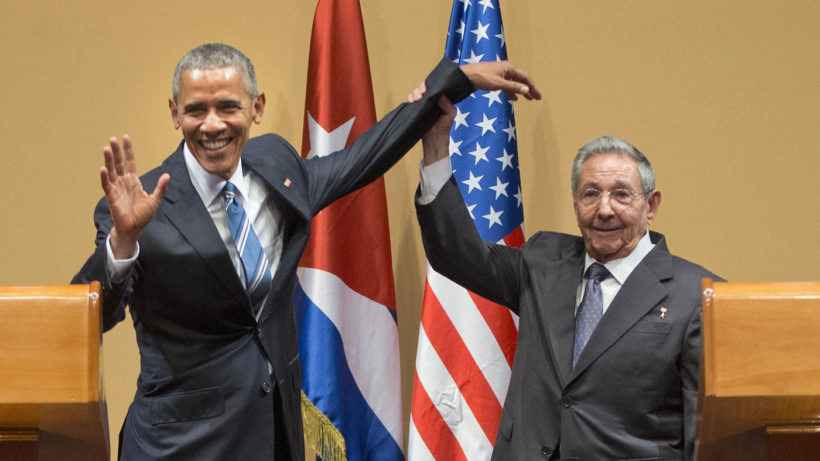 Raúl Castro lifts up President Obama's arm at the conclusion of Monday's joint news conference at the Palace of the Revolution in Havana.