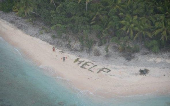 Stranded sailors signal for help on tiny uninhabited Pacific island of Fanadik.