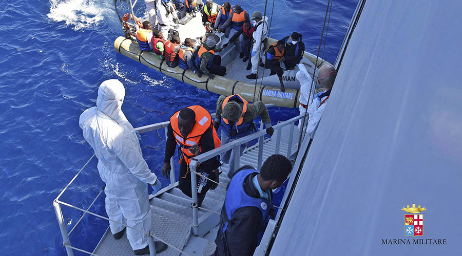 Migrants sit in a rescue boat during a rescue operation by Italian Navy vessels off the coast of Sicily in this April 11, 2016 handout picture provided by Marina Militare.