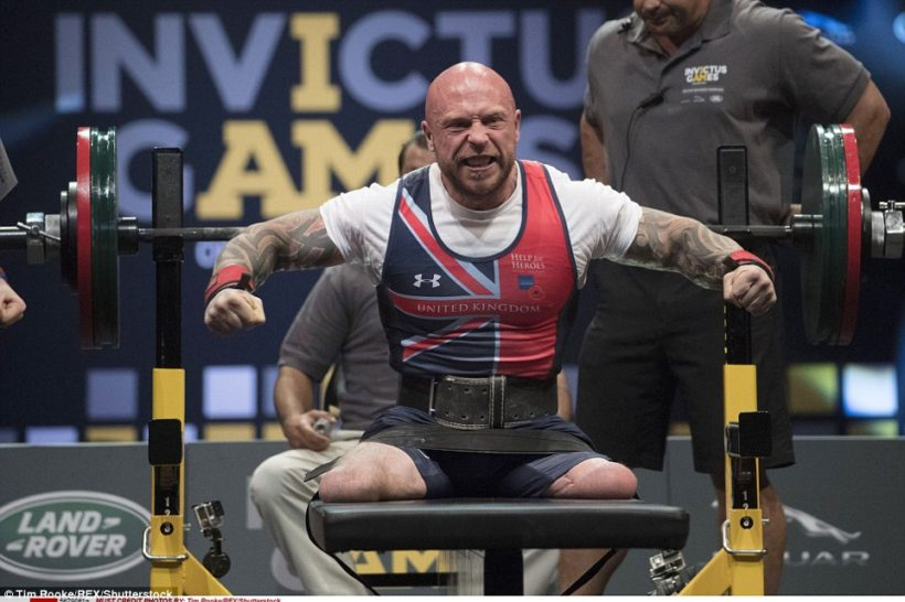 Power lifter Michael Yule, who lost both legs to a Taliban bomb in Afghanistan, as he lifted 418.9 pounds to win the first gold medal for Britain.