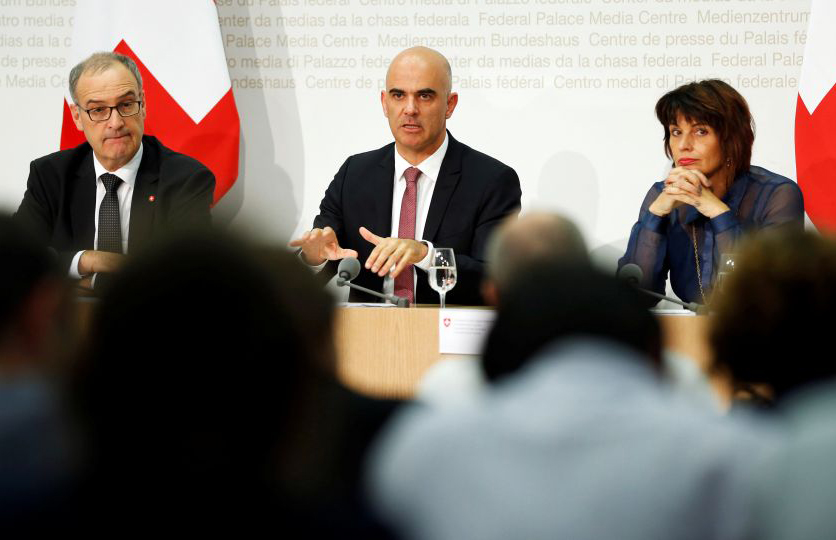 Swiss Defence Minister Guy Parmelin (L-R), Interior Minister Alain Berset and Energy Minister Doris Leuthard attend a news conference following the vote results in Bern September 25, 2016.