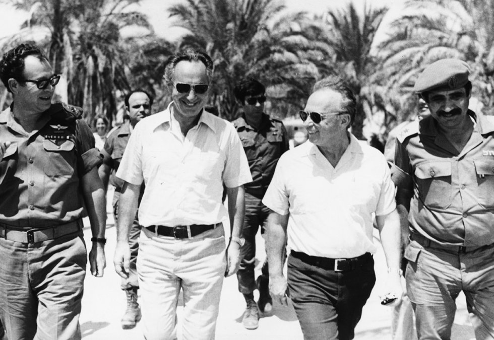 June 1967: Israeli Prime Minister Yitzhak Rabin (second right) walks with Shimon Peres (second left) and Mordechai Gur (left), and Deputy Chief of Staff General Yekutiel Adam (right) during a tour of the forces on the Egyptian Front in Sinai during the Six Day War.