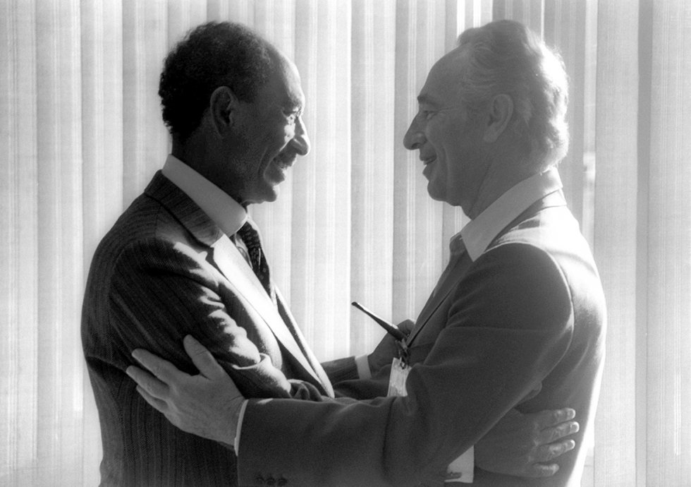 May 25, 1979: Egyptian President Anwar Sadat greets then Israeli opposition leader Shimon Peres in the southern Israeli city of Beersheva. Two months earlier, Israel and Egypt had signed their historic peace treaty, making Egypt the first Arab nation to recognize the Jewish State