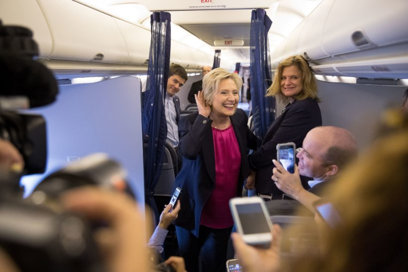 Hillary Clinton, accompanied by traveling press secretary Nick Merrill, left, and director of communications Jennifer Palmieri, right, Sept. 6, 2016. (AP Photo/Andrew Harnik)