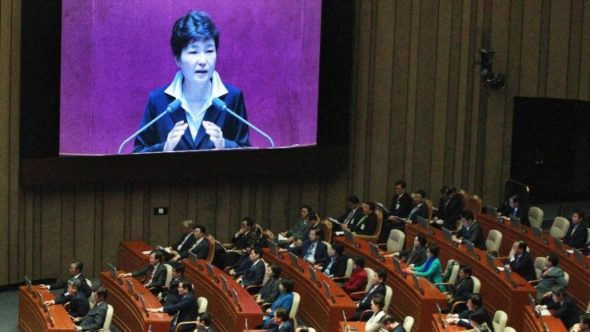 South Korean President Park Geun-hye, shown on a large screen, delivers a speech at the National Assembly in Seoul, South Korea, Monday, Oct. 24, 2016. (AP Photo/Ahn Young-joon)