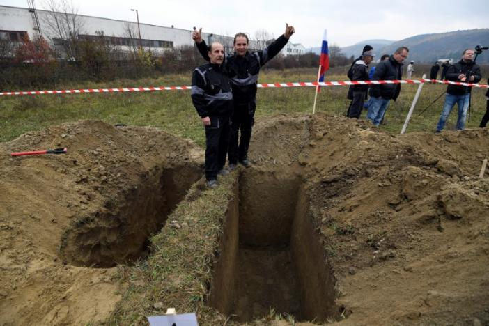 Winners, brothers Ladislav (L) and Csaba Skladan from Slovakia, pose for a photo during a grave digging championship in Trencin, Slovakia, November 10, 2016, where eleven pairs of gravediggers are competing in digging based on accuracy, speed, and aesthetic quality. (Photo: Reuters/Radovan Stoklasa)