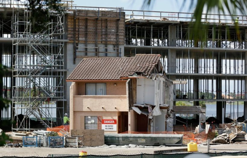 Construction of a timeshare resort goes on around the condo of Julieta Corredor, an 81-year-old widow who refused to sell her unit to one of the nations largest timeshare companies. (AP Photo/John Raoux)