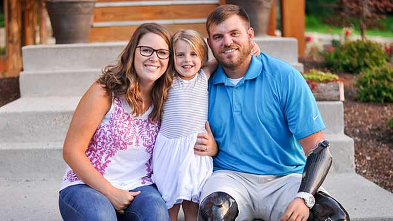 Retired U.S. Army Staff Sgt. Travis Mills is one of only five servicemen from the Iraq and Afghanistan wars to survive as a quadruple amputee. With his wife Kelsey and daughter Chloe.