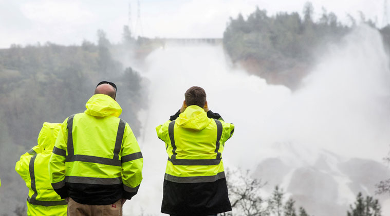 Officials won't lift evacuations for 188,000 as flood danger around Calif. dam eases