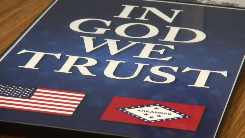 "Arkansas schools display ""In God we trust"" posters"