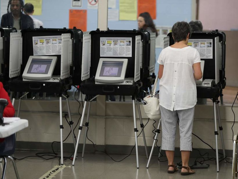 Judge rules Georgia can still use electronic voting machines despite concerns over hacking