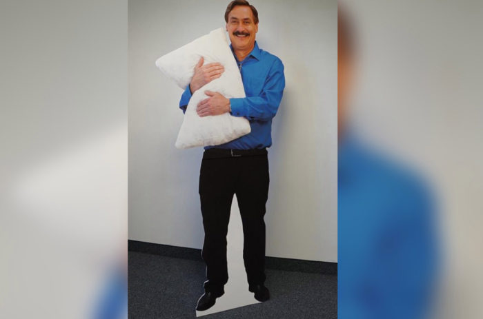 Deranged man hugging pillow in the cold