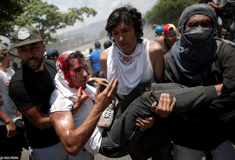Venezuela protests turn violent as Guaido calls for end of Maduro regime